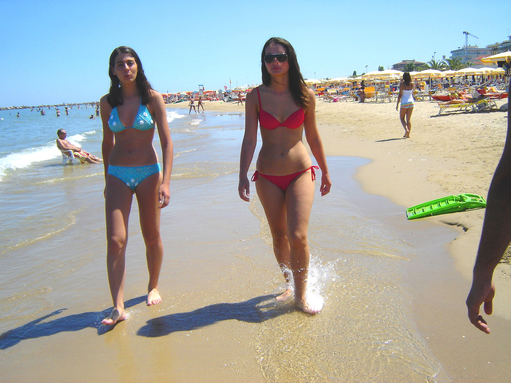 2 Girls Walking On Beach