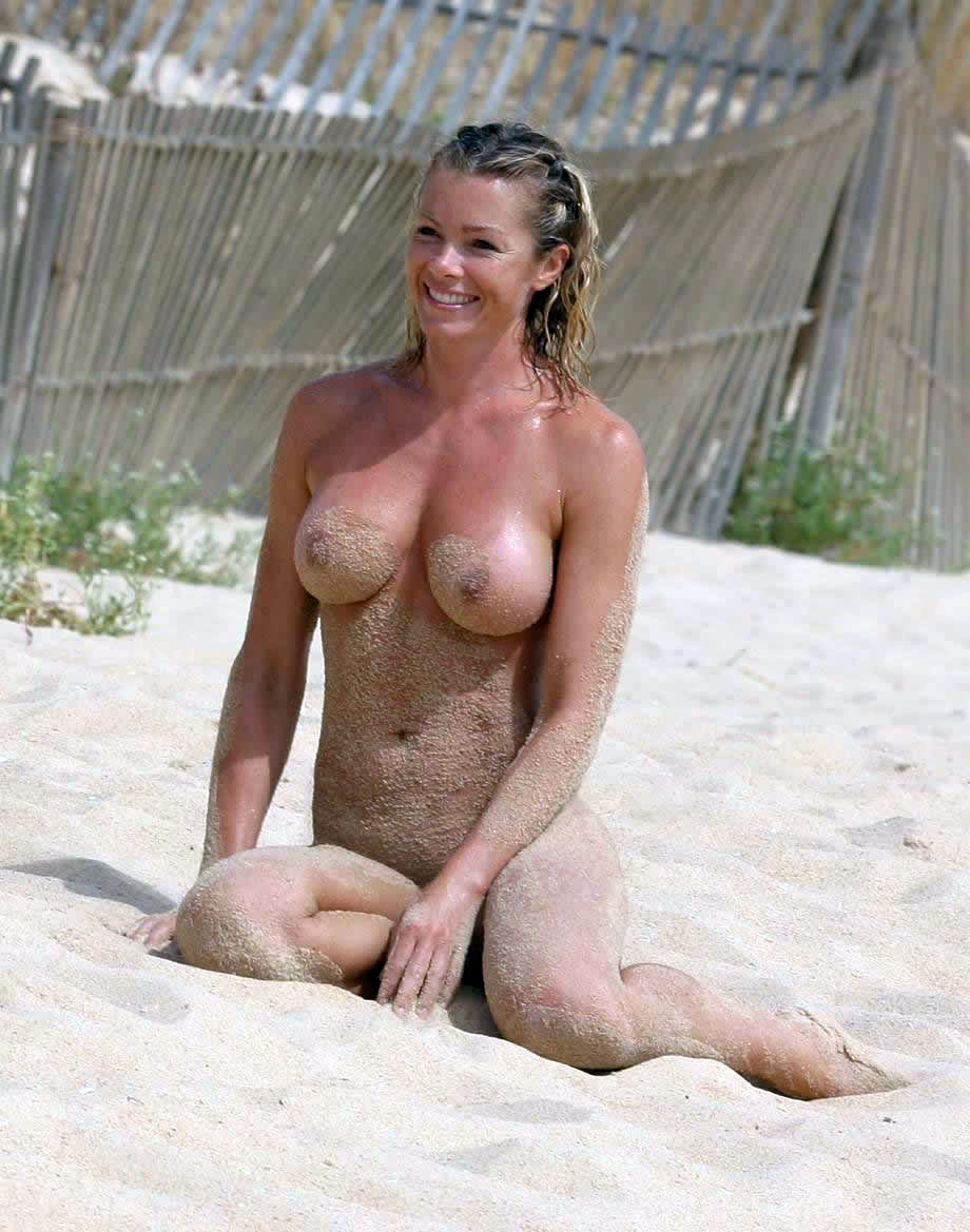 Busty Blonde Playing In Sand